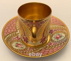 Antique porcelain Limoges coffee cup and saucer, decorated with hand painted flo